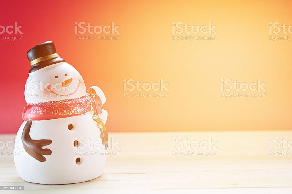 Cute snowman on  wood, red background foto stock royalty-free