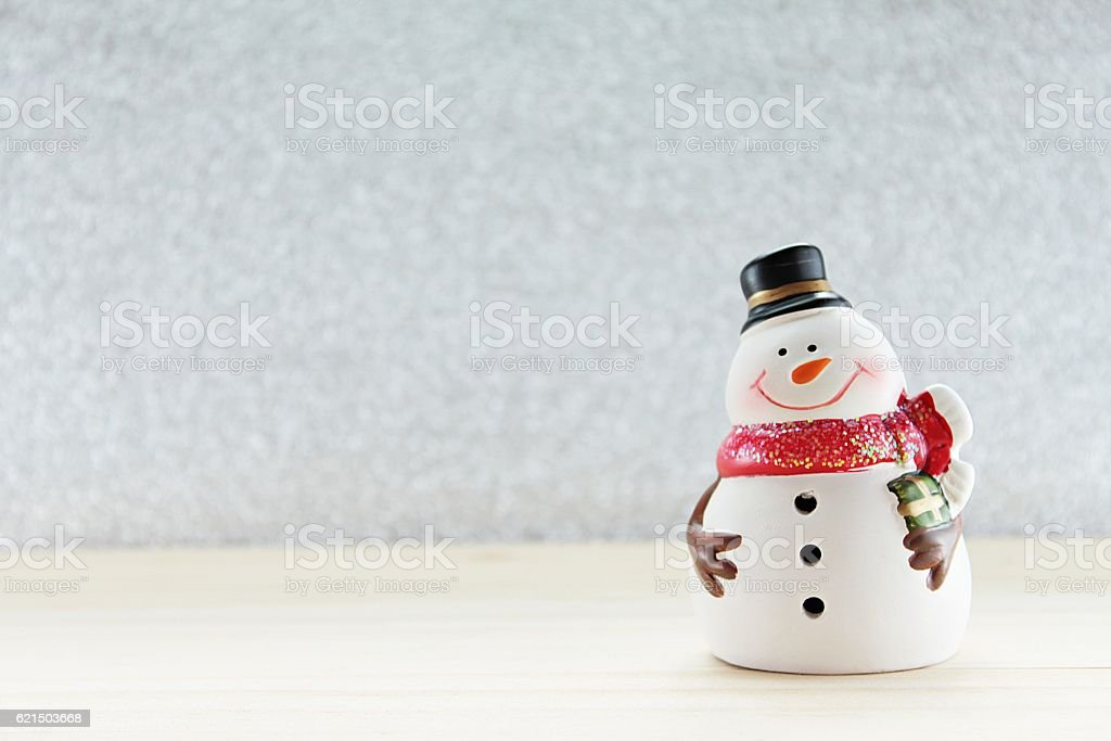 Cute snowman on  wood, silver glitter background photo libre de droits