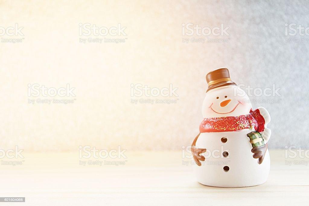 Cute snowman on  wood, silver glitter background photo libre de droits