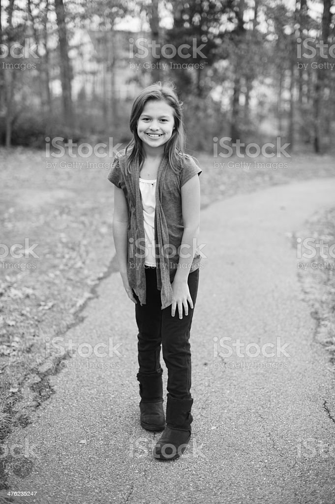Cute Spanish Girl Standing Outside During Autumn royalty-free stock photo