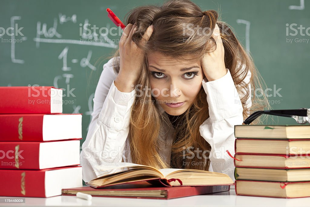 Cute student studying stock photo
