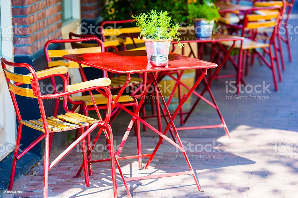 Cute summer empty outdoor cafe at tourist city stock photo