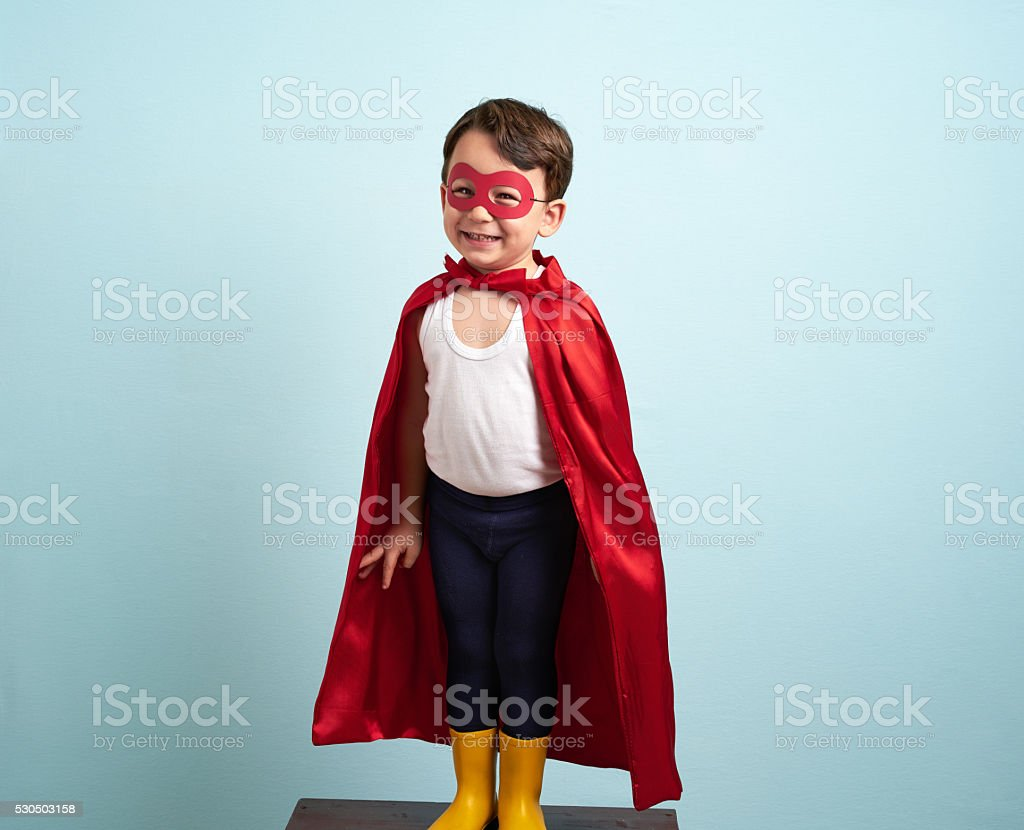 Cute superhero kid stock photo