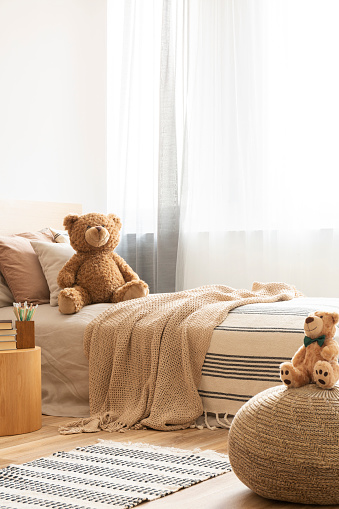 Cute Teddy Bear On Single Bed In Bright Kids Room Stock Photo Download Image Now Istock