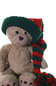 Cute Teddy at Christmas time. Taken in a studio with a white background. Teddy is wearing an elf hat.
