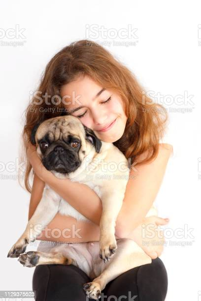 Cute teen girl hugging and kissing a pug dog on white background picture id1129375523?b=1&k=6&m=1129375523&s=612x612&h=vb5ilskvkqxghqgq ecngr8u1125bzrbuk3o7alvmag=