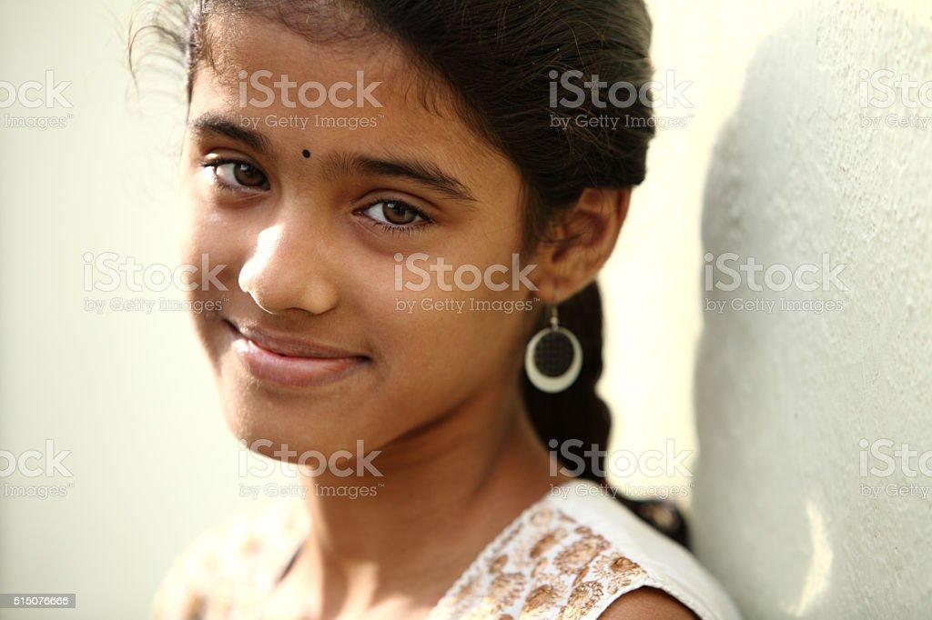 Cute teen girl smiling stock photo