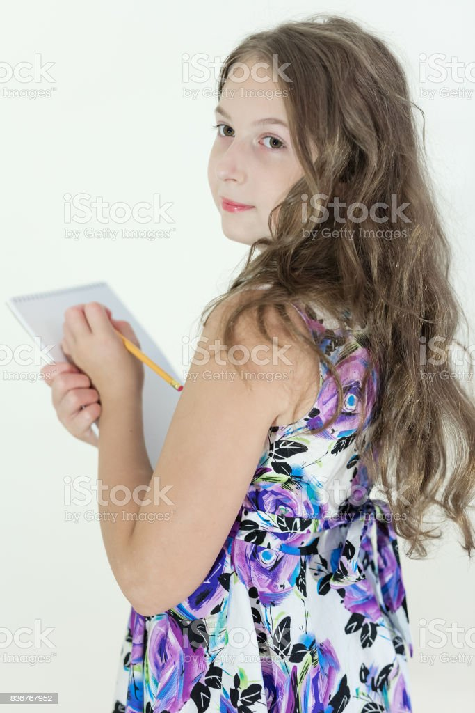 Cute Teen Girl With Notepad Royalty Free Stock Photo