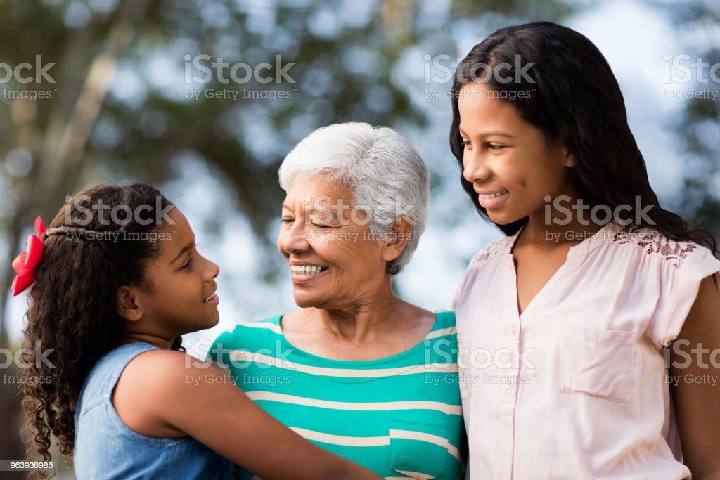 Cute teen girls and their grandmother bonding outdoors - Royalty-free 12-13 Years Stock Photo