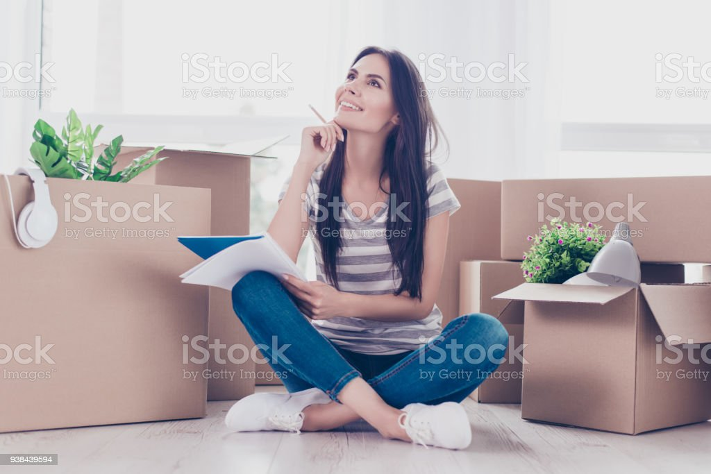 Cute Teen In Casual Clothes Is Sitting With Crossed Legs On The Floor A Lot