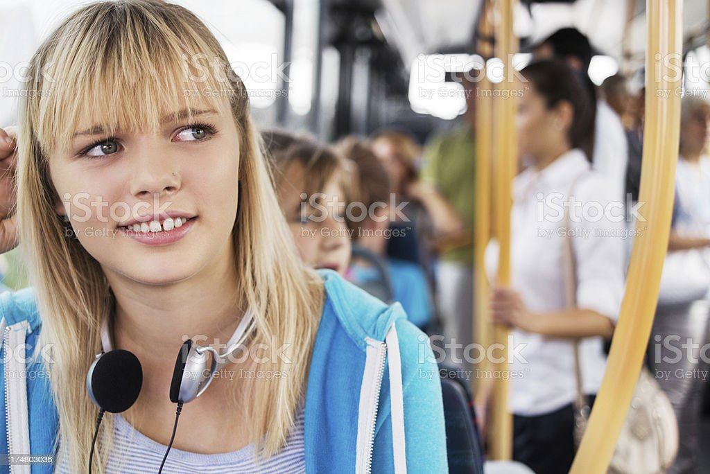 Cute teenage girl commuting by bus. royalty-free stock photo