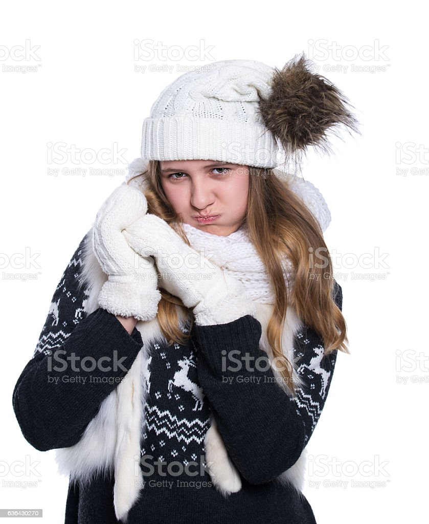 83772ddd8 Cute teenage girl posing in the studio. Wearing winter clothes. - Stock  image .