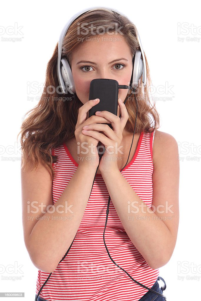 Cute teenager girl listens to music on headphones royalty-free stock photo
