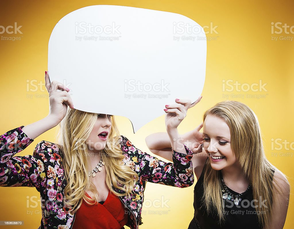 Cute teenagers with big speech bubble royalty-free stock photo