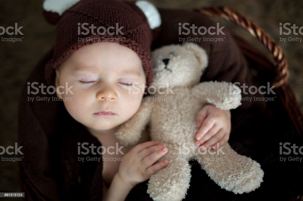 81fdec1b4 Cute Three Months Old Baby With Bear Hat In A Basket Sleeping Stock ...