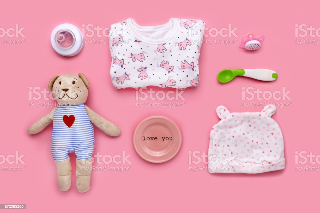 Cute toddler (girl) accessories on a pink background shot knolling style stock photo