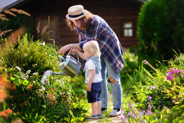 Cute toddler boy and his mat summer sunny day stock photo