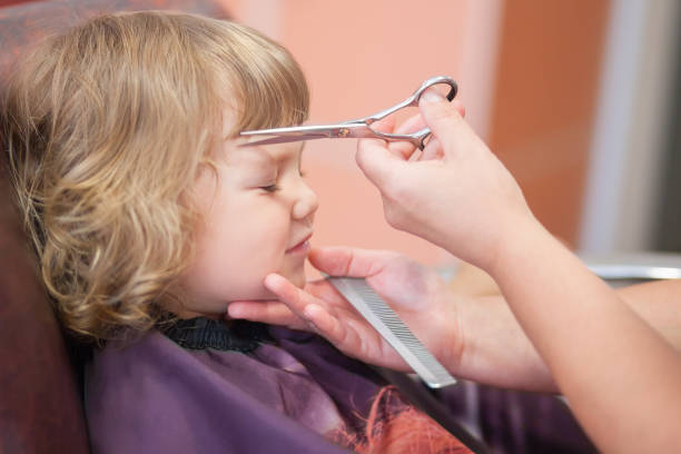 Cute toddler girl at the beauty salon stock photo