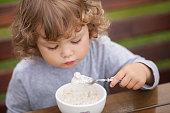 istock Cute toddler girl having breakfast. 856038262