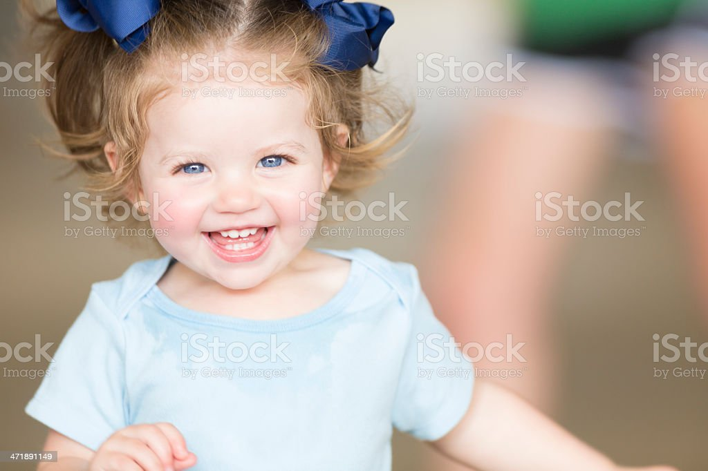Cute toddler girl laughing and smiling stock photo