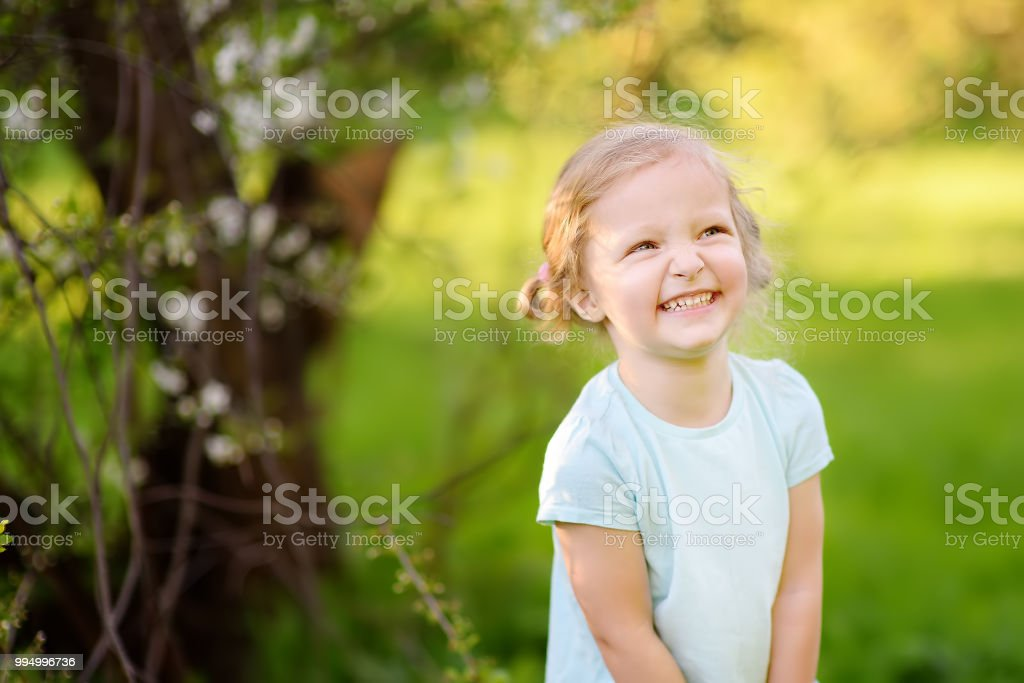 Cute toddler girl outdoors portrait in summer day royalty-free stock photo