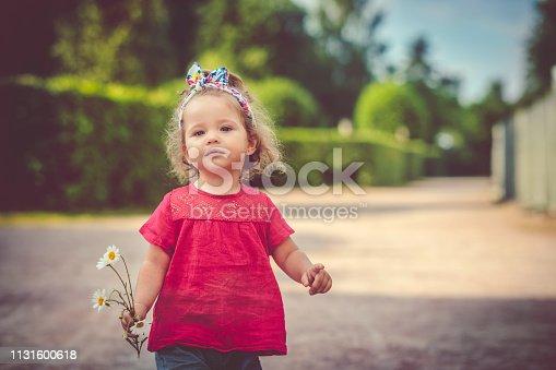 Happy child having fun in summer park