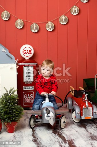 486524205 istock photo Cute toddler is playing with toy cars. Rides a toy typewriter airplane. Happy childhood 1183454102