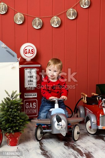 486524205 istock photo Cute toddler is playing with toy cars. Rides a toy typewriter airplane. Happy childhood 1183992831