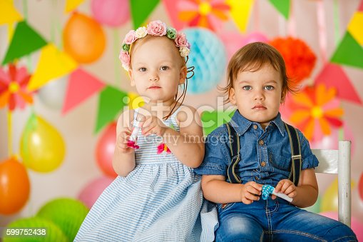 istock Cute toddler twins at birthday party 599752438