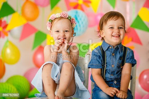 istock Cute toddler twins at birthday party 599752552
