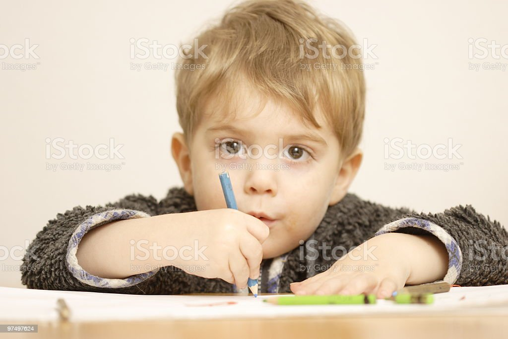 Cute toddler with crayons royalty-free stock photo