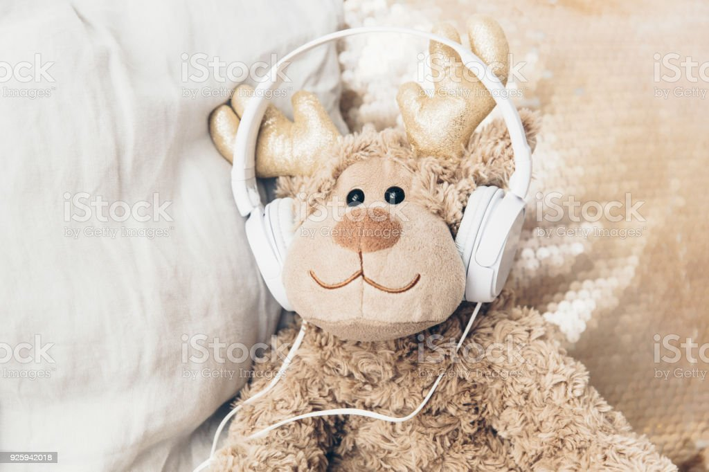 Cute toy with headphones. Audiobooks for children concept stock photo