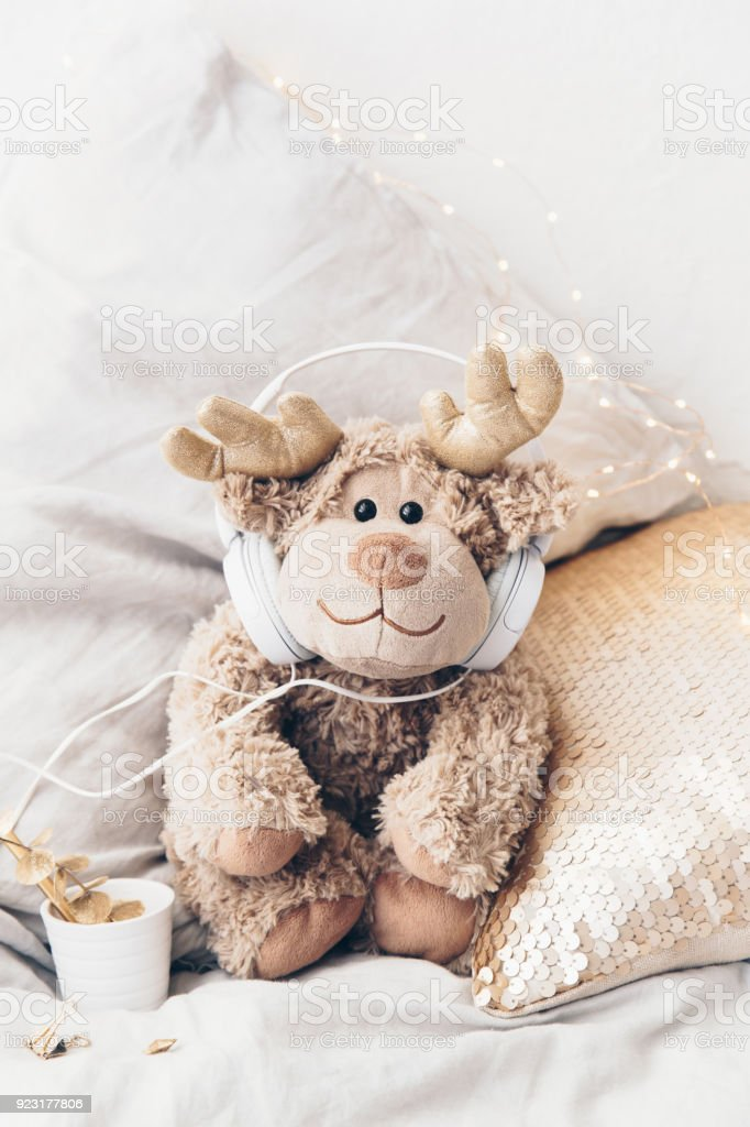 Cute toy with headphones. Audiobooks or Music for Children Concept stock photo