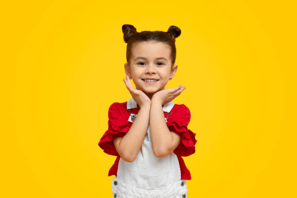Cute trendy child looking at camera stock photo