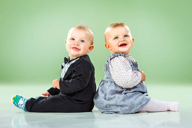Cute twin brother and sister stock photo