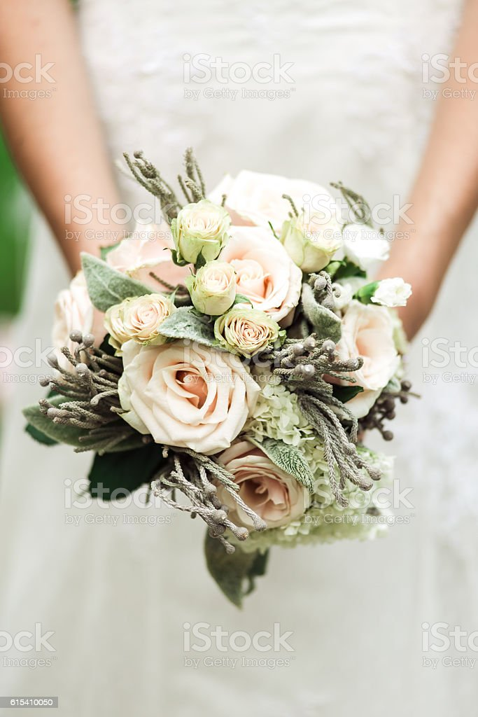cute wedding bouquet in gentle female hands stock photo