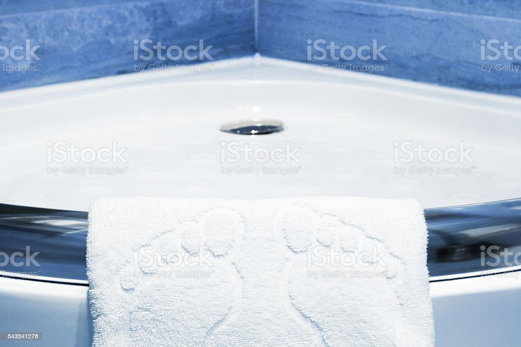 Cute white bathmat with footprints stock photo