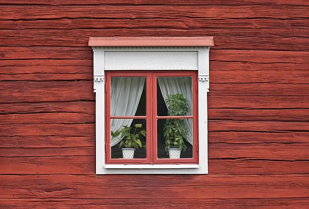 Cute Window on Red Wooden Wall bildbanksfoto