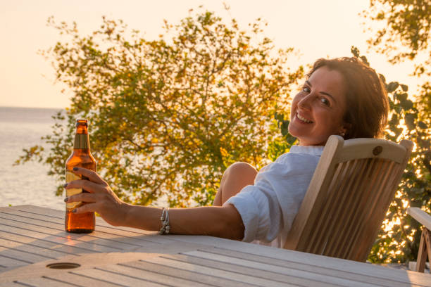 Cute woman drinking beer. stock photo