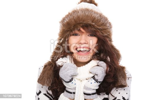 istock Cute woman in winter outfit 1073679224