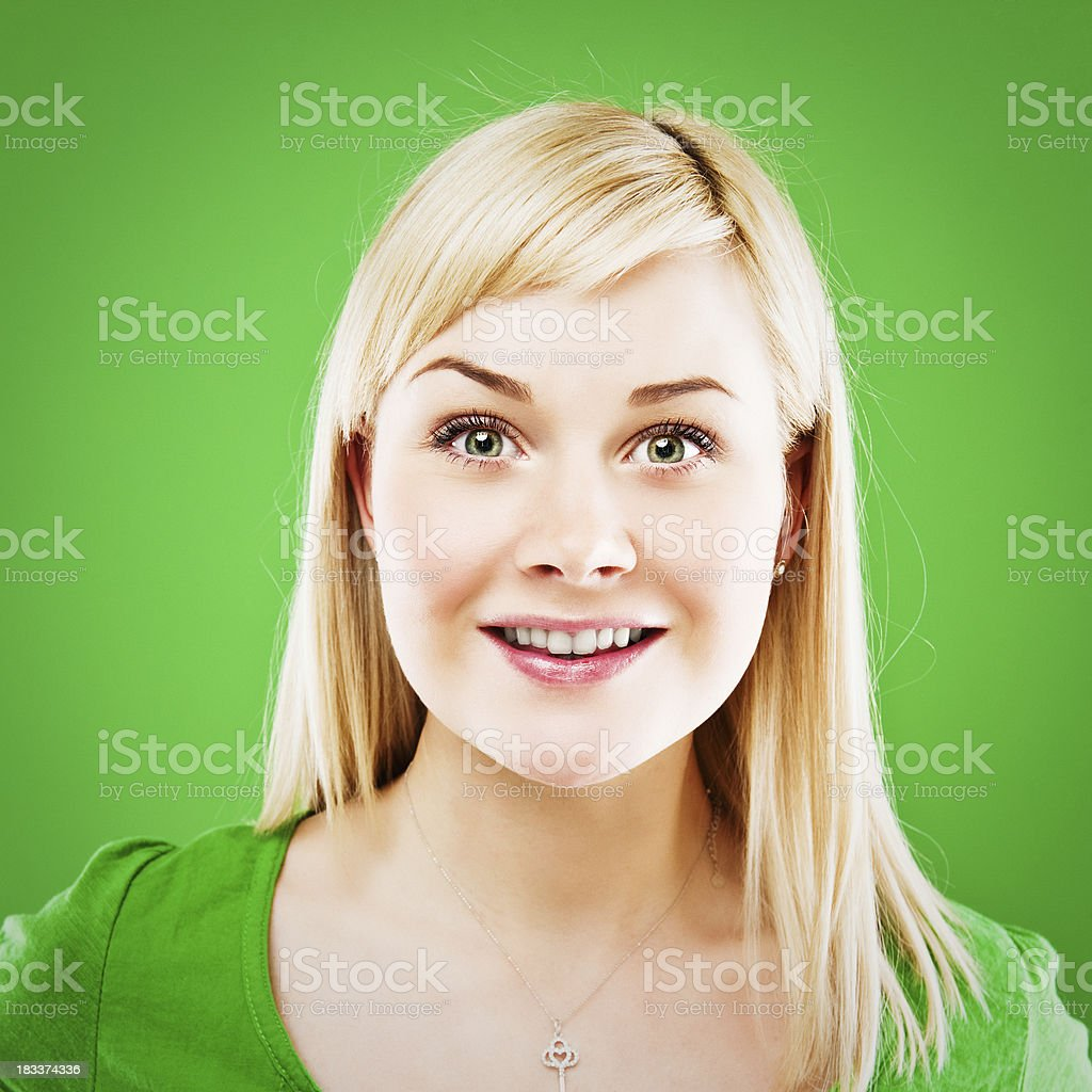Cute woman isolated on clear green royalty-free stock photo