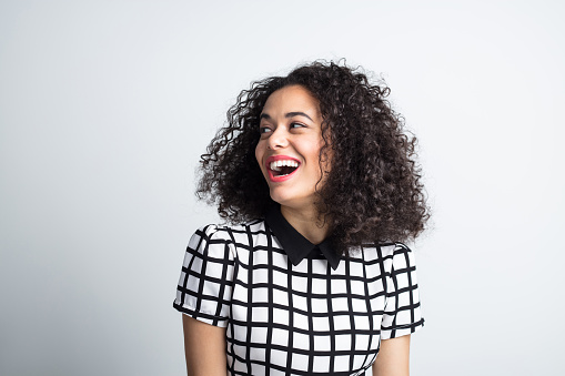 Cute Woman Looking Away And Laughing Stock Photo - Download Image Now