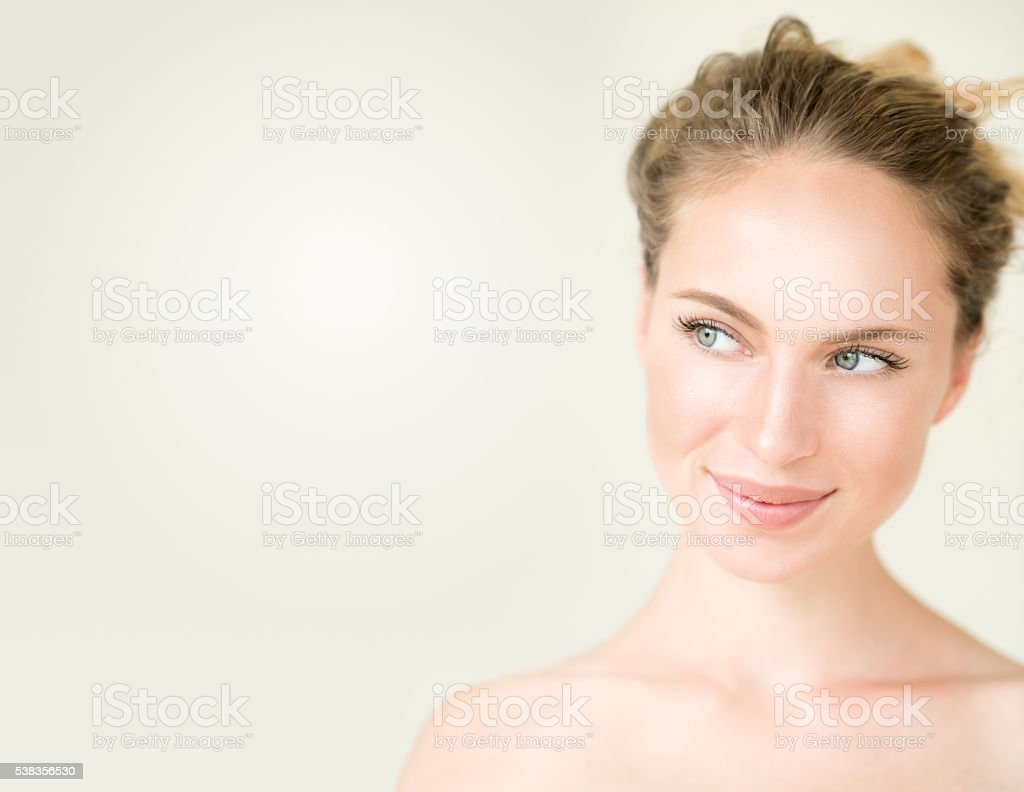 Cute Woman looking into free copy space stock photo