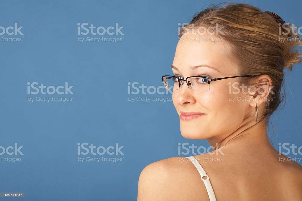 Cute woman looking over her shoulder royalty-free stock photo