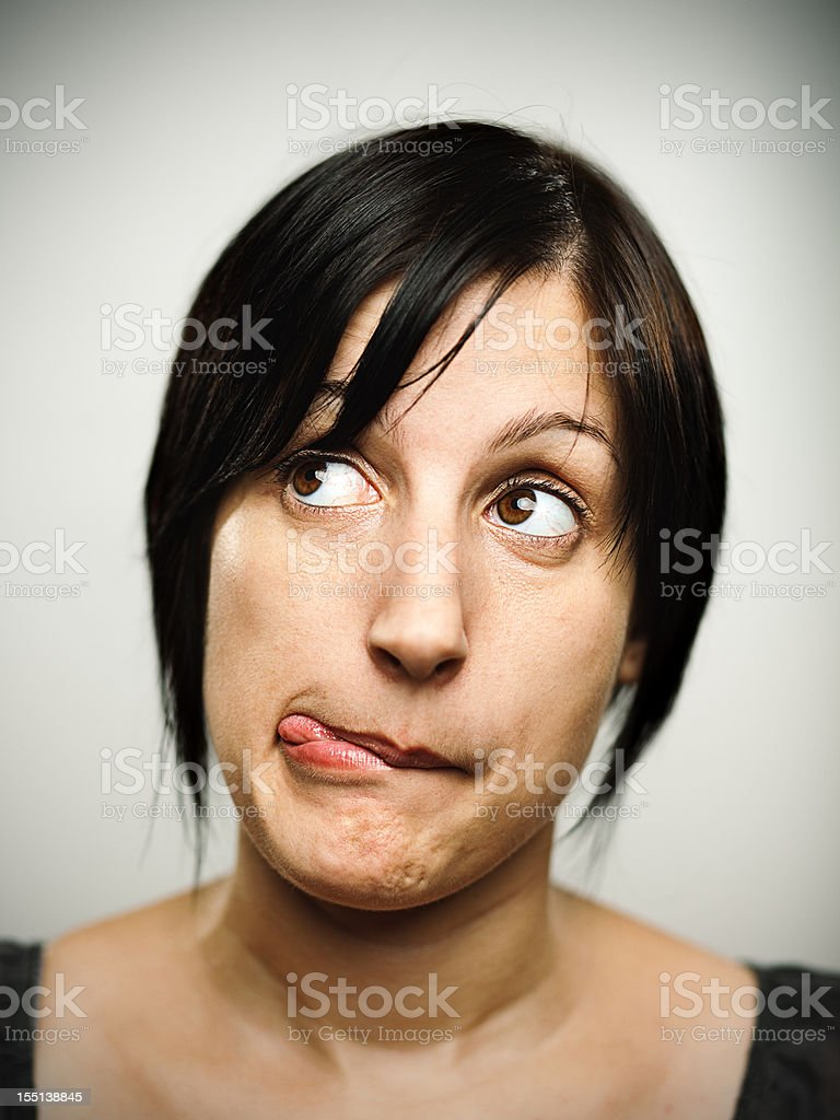 Cute woman making a face royalty-free stock photo