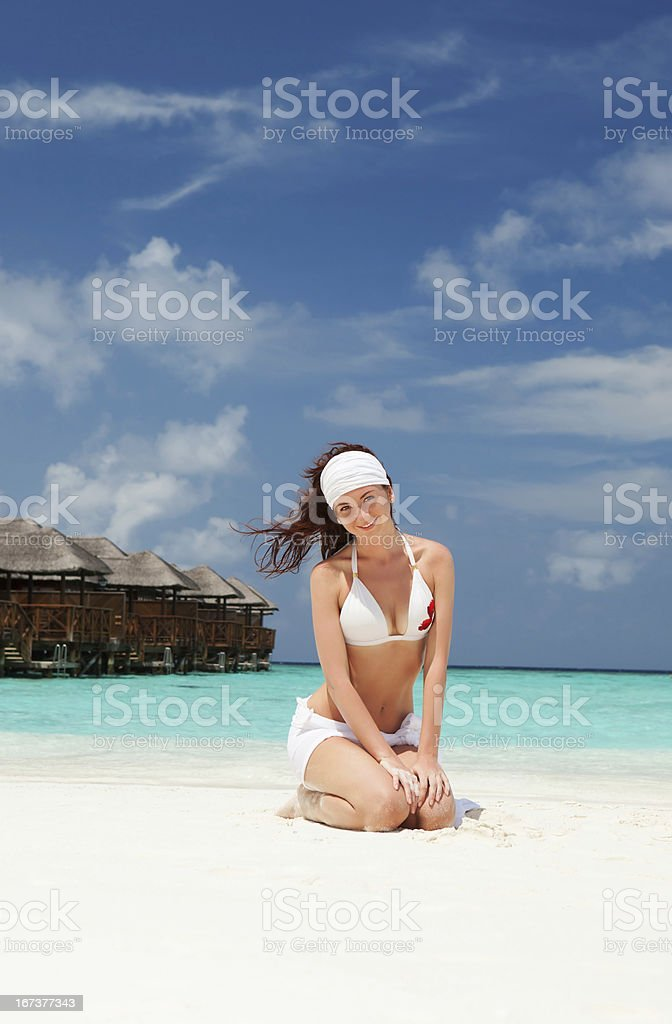 Cute woman relaxing on the beach royalty-free stock photo