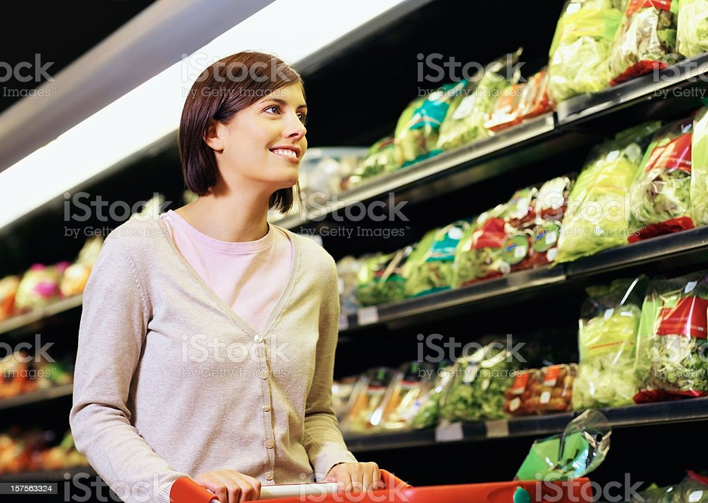 Cute woman shopping at the supermarket royalty-free stock photo