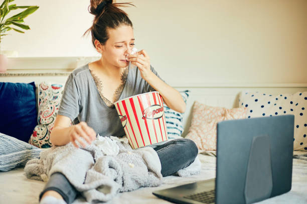 Cute woman watching movie at home. stock photo