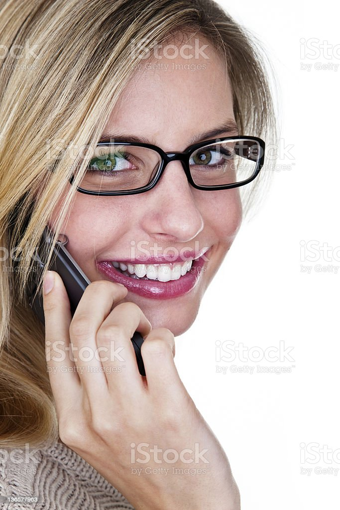 Cute woman wearing glasses speaking on phone royalty-free stock photo