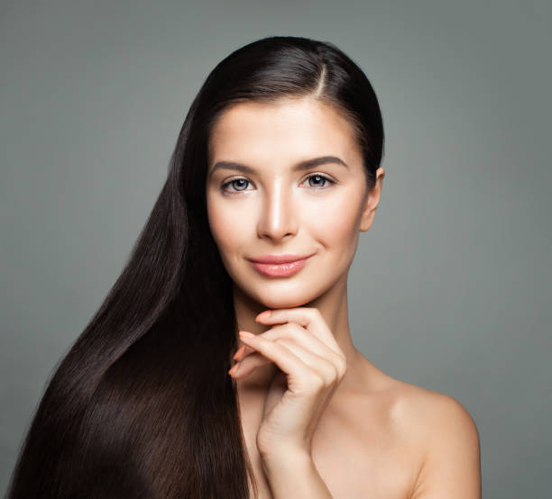 Cute Woman with Beautiful Long Straight Hair. Haircare Concept Cute Woman with Beautiful Long Straight Hair. Haircare Concept root hair stock pictures, royalty-free photos & images